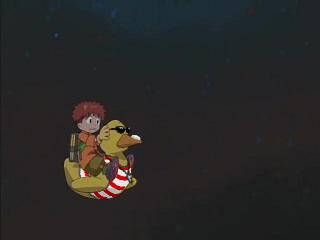 Koushirou riding a ducky pool float that's dressed up like a lifeguard.